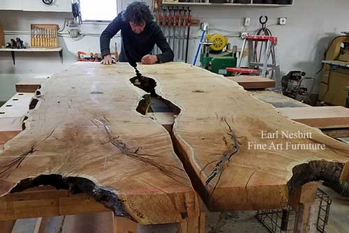 Earl designing notch for glass on mesquite slabs for custom made live edge dining table